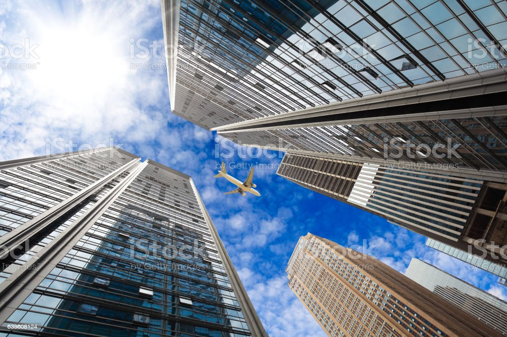 Looking up at modern city buildings backgrounds stock photo