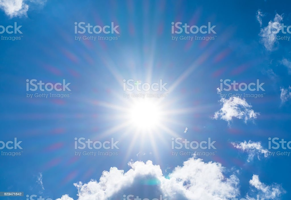 Looking up at Nice blue sky with sun beam stock photo