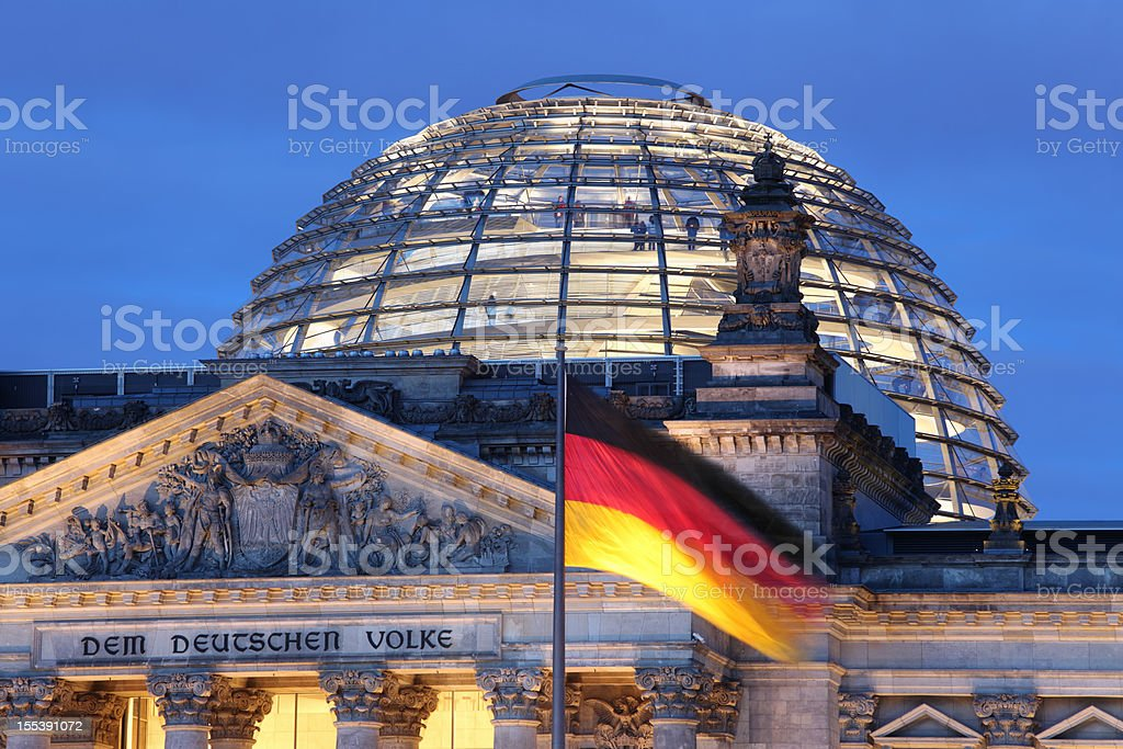 Looking up at Reichstag Dome illuminated stock photo