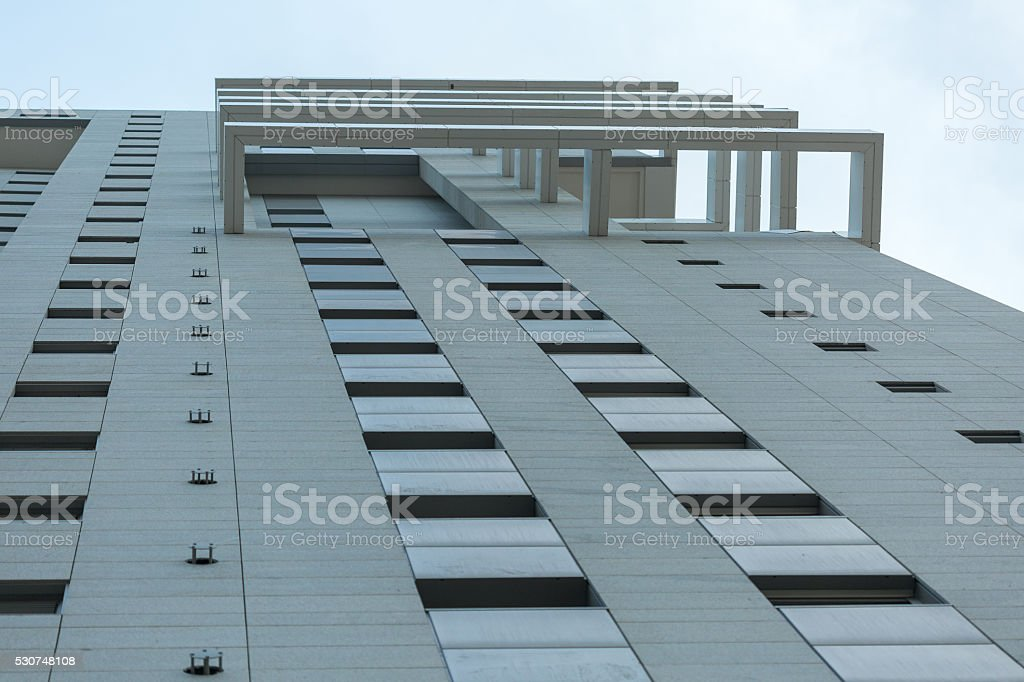 Looking up at residential building wall stock photo