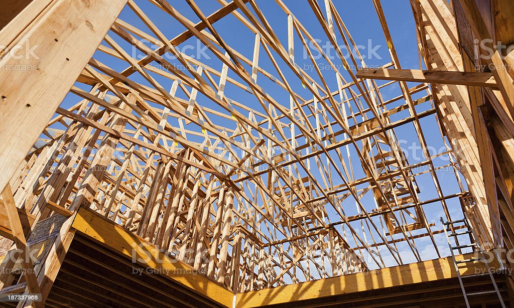 Looking up at Rows of Wood Roof Trusses royalty-free stock photo