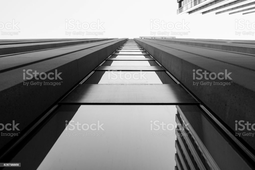 looking up at skyscraper windows stock photo