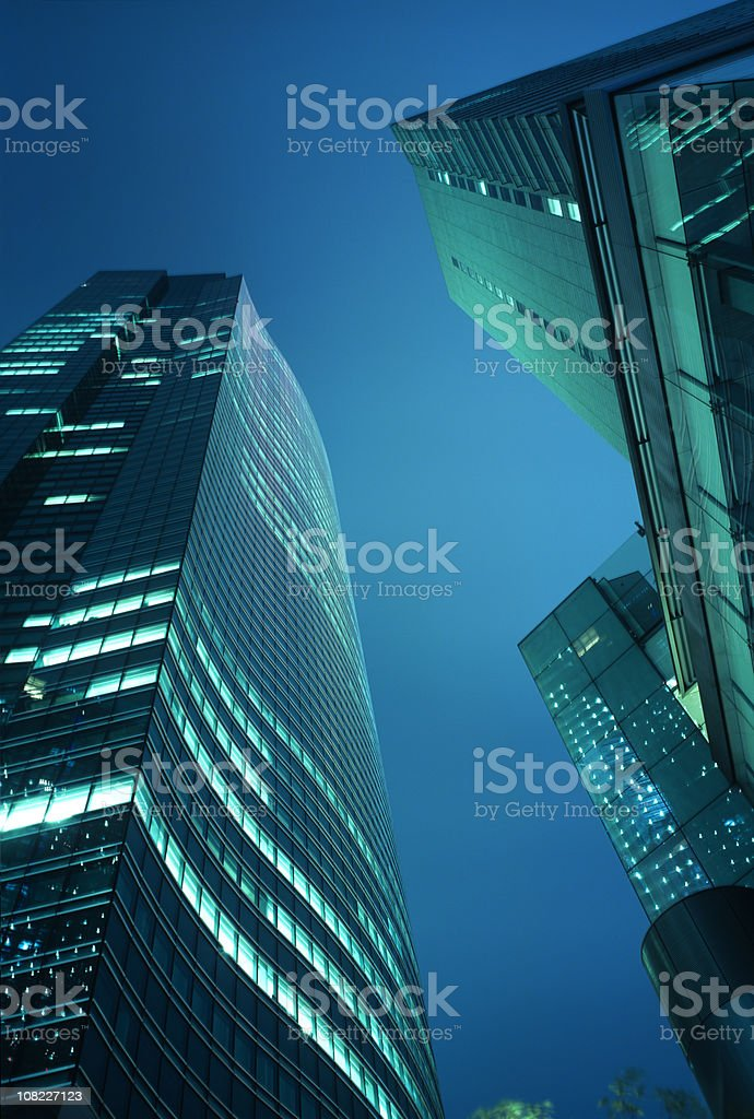 Looking up at Skyscrapers During Night royalty-free stock photo