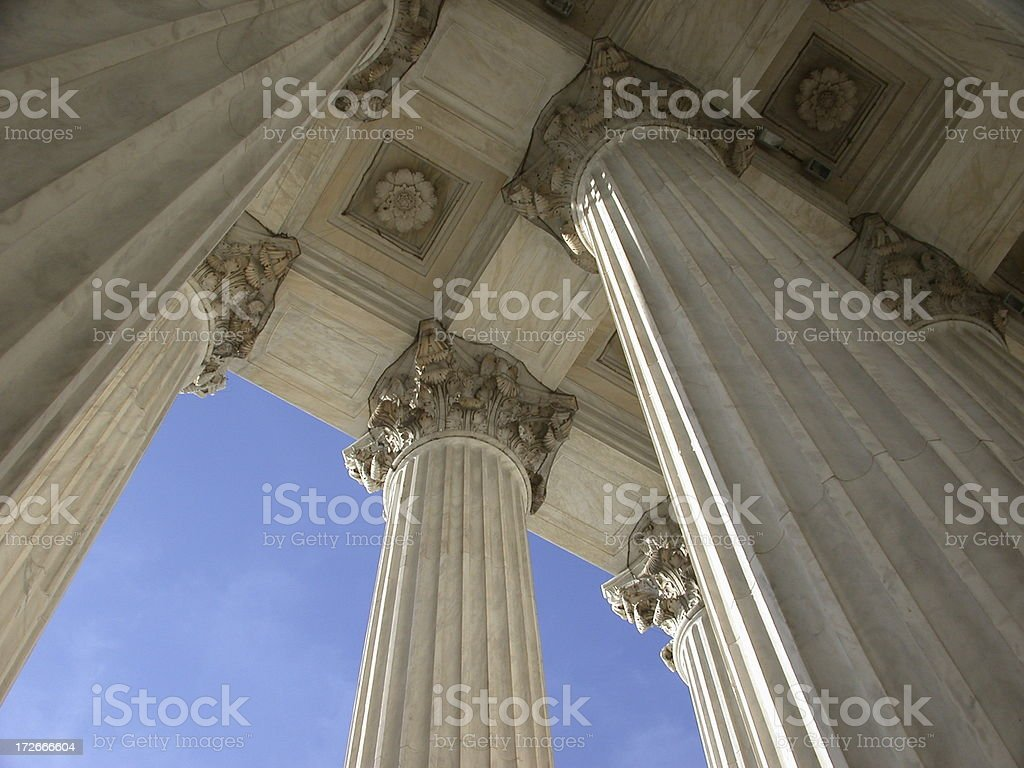 Looking up at the majestic white columns of Supreme Court royalty-free stock photo