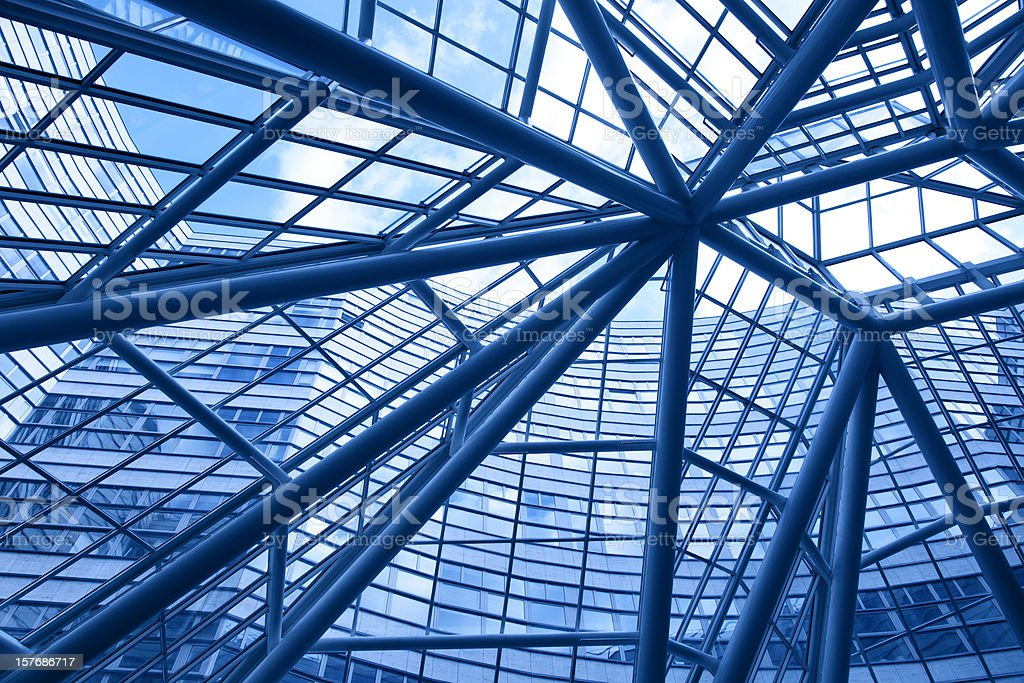 looking up into modern glass and steel business facade royalty-free stock photo