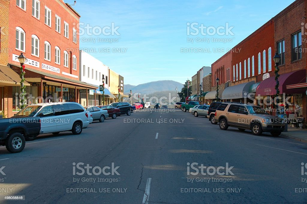 Looking up middle of street of NC mountain town stock photo