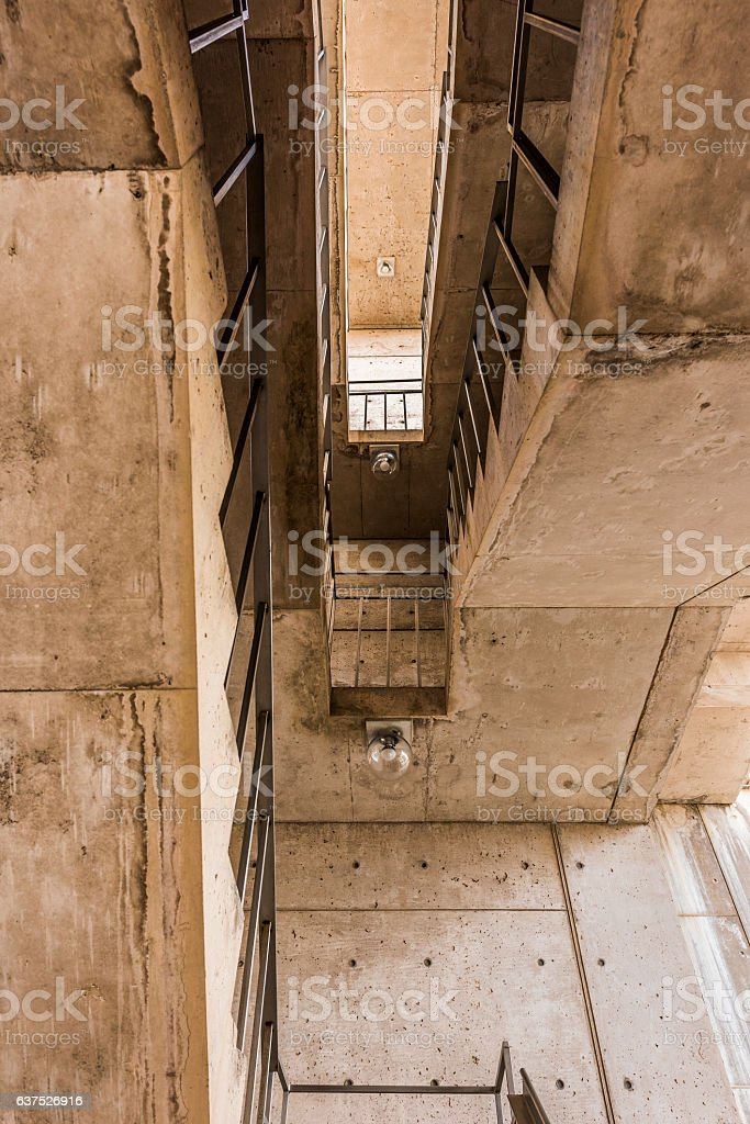 Looking up on cement modern stairway staircase stock photo