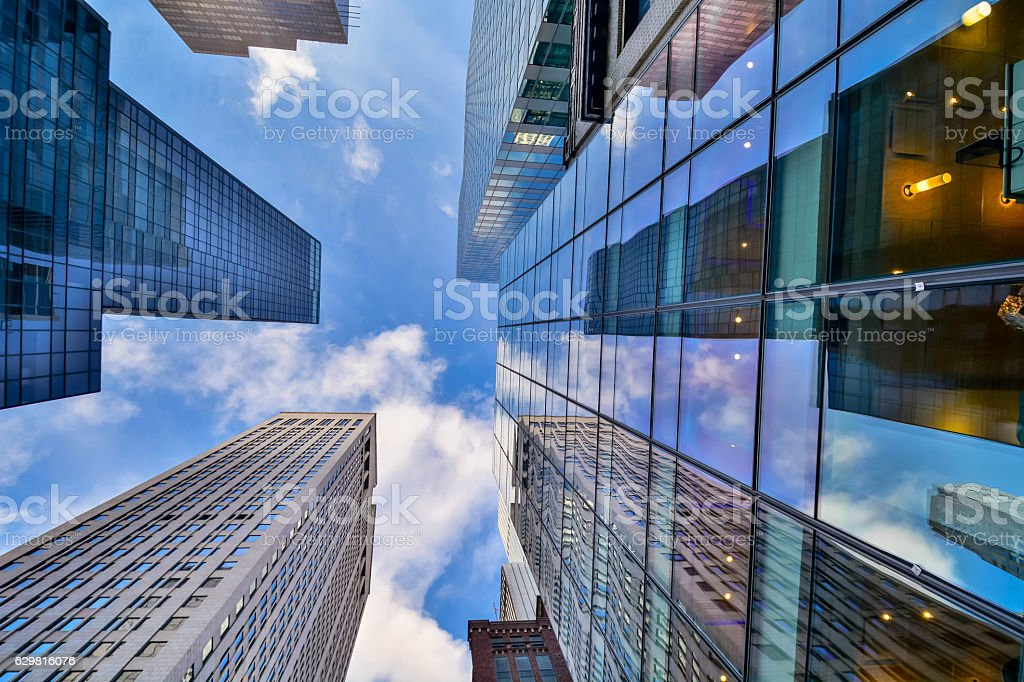 Looking up skyscrapers in nyc stock photo