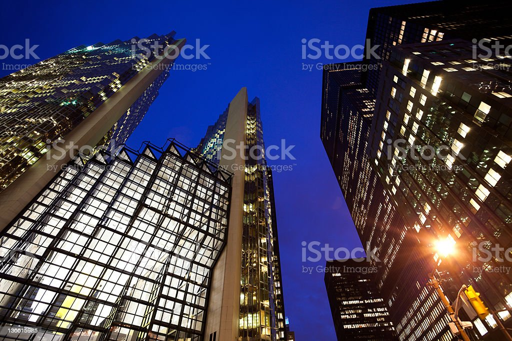 Looking up skyscrapers in Toronto by night stock photo