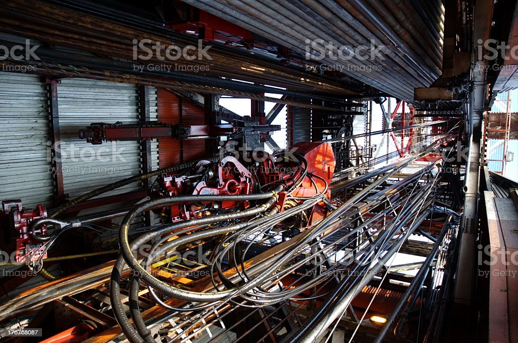 Looking up the inside of a derrick on an offshore oil rig stock photo