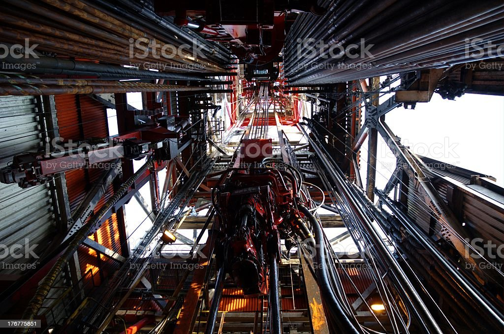 Looking up the inside of a derrick on an offshore oil rigLooking stock photo
