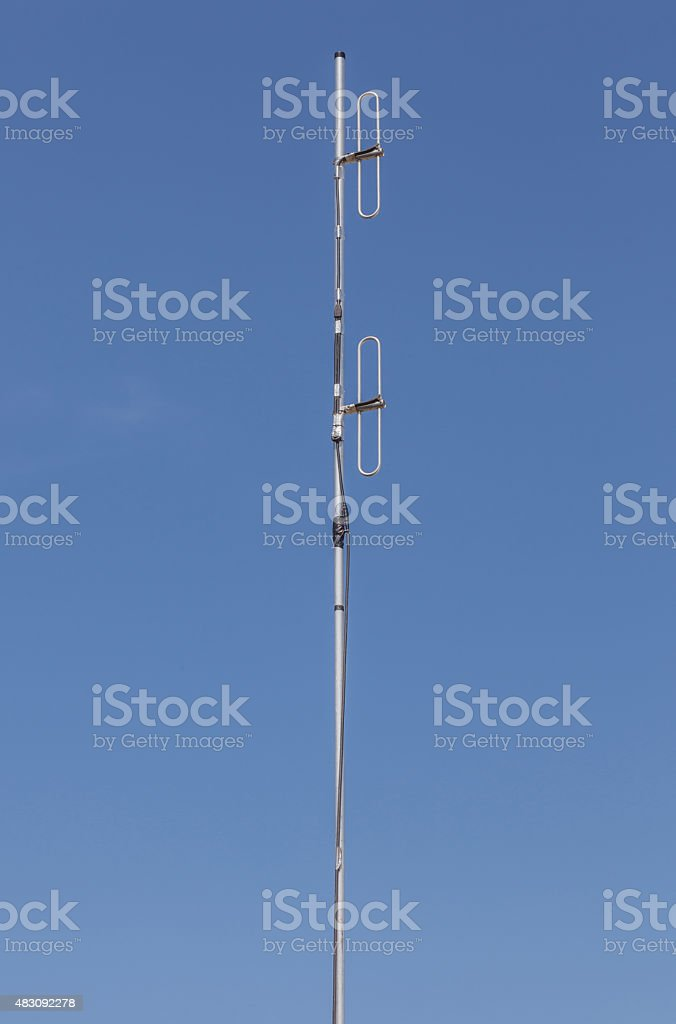 Looking up the telecommunication dipole antenna. stock photo