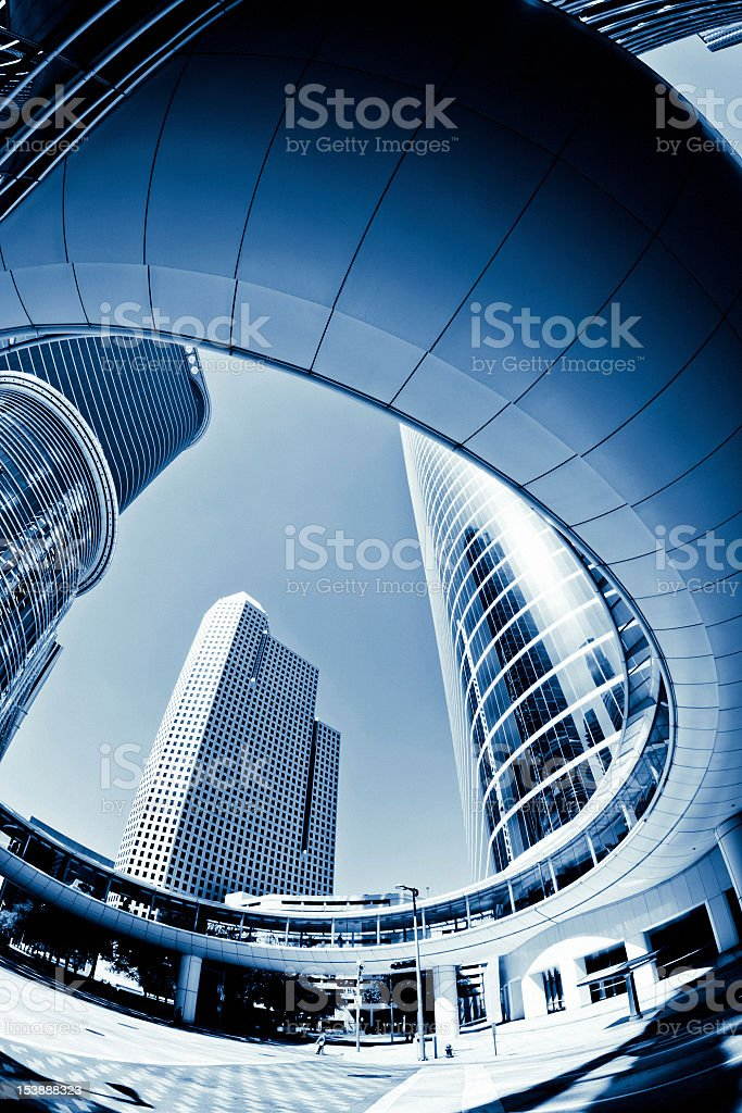 Looking up through a hole at three skyscrapers and the sky stock photo