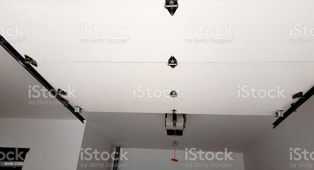 Looking Up To Mechanics Of An Automatic Garage Door stock photo