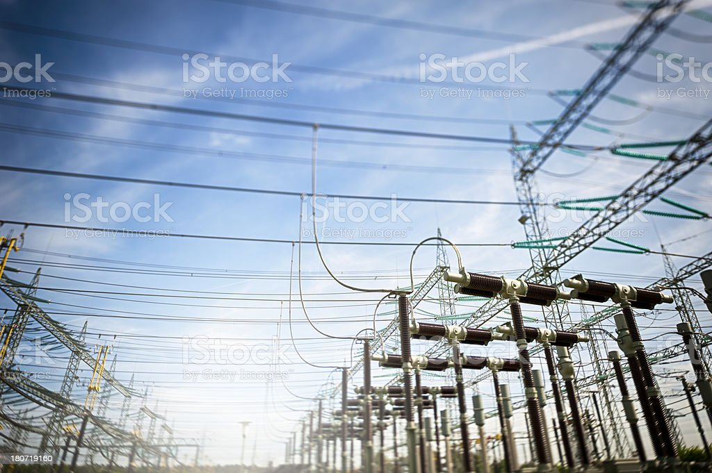 Looking up to the overhead wires at a transformer station stock photo