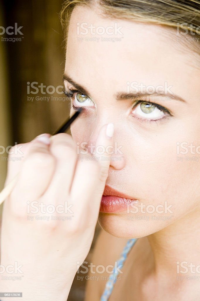 Looking Up While Applying Make-Up royalty-free stock photo
