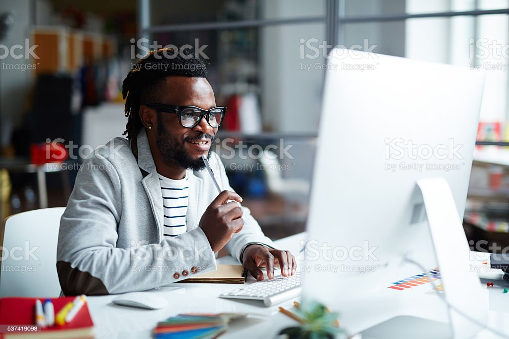 Lookng at computer screen stock photo