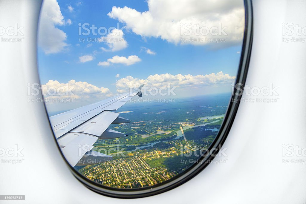lookout of aircraft window to landscape while landing royalty-free stock photo