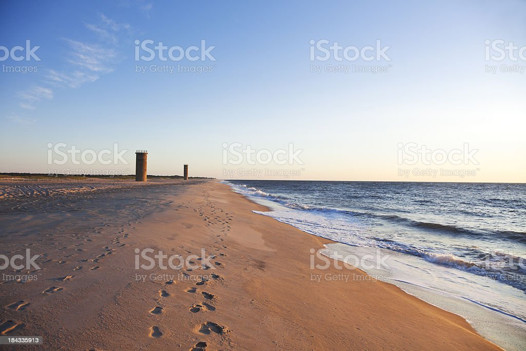 Lookout tower on the beach next to the sea stock photo