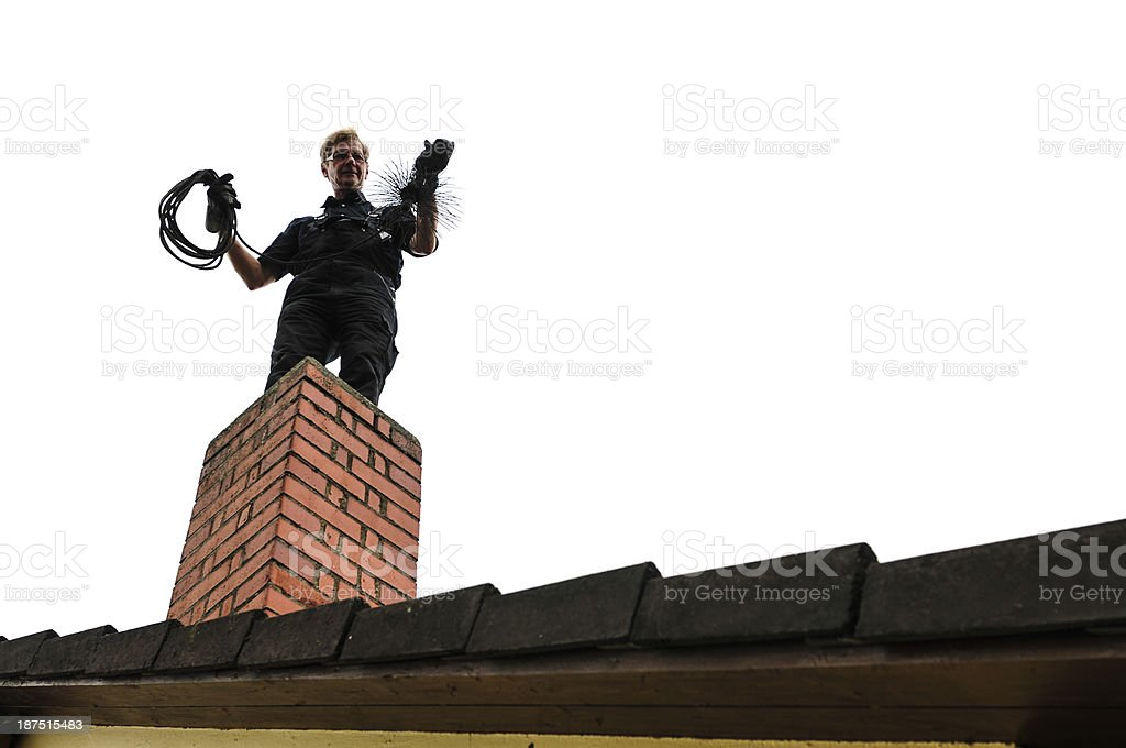 Look-up of cleaner cleaning brick chimney stock photo