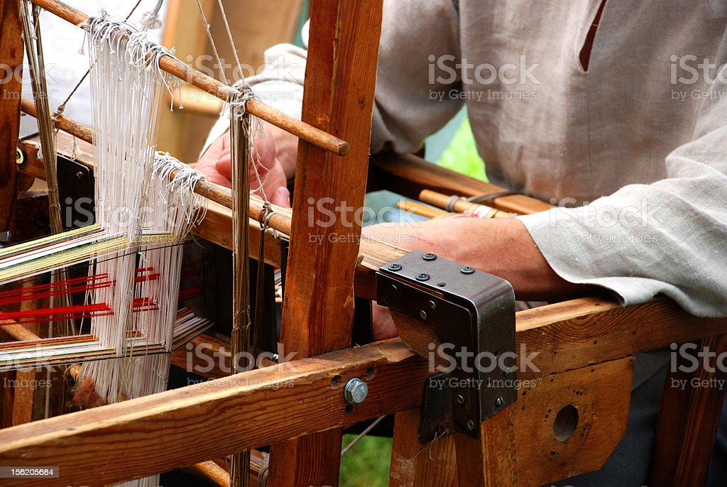 Loom and Hands royalty-free stock photo