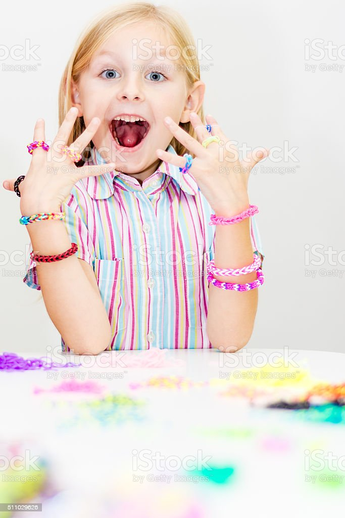 Loom bracelets  and rings. Young fashion concept stock photo