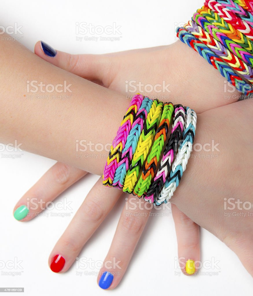 Loom bracelets on a young girl's hand. Close up. Young fashion royalty-free stock photo