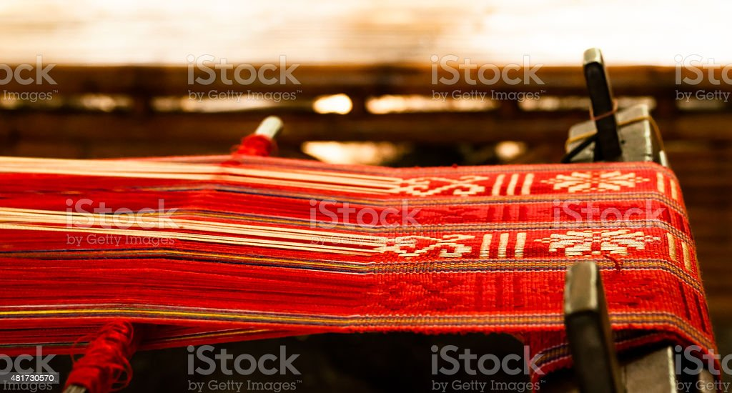 Loom with red textile stock photo