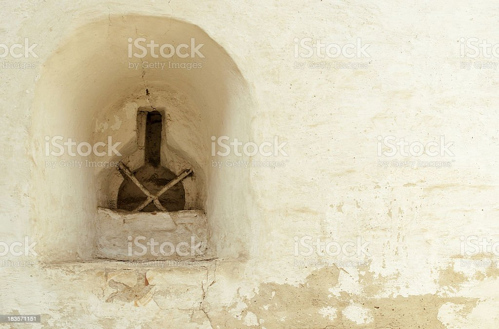 Loophole in a wall of monastery royalty-free stock photo