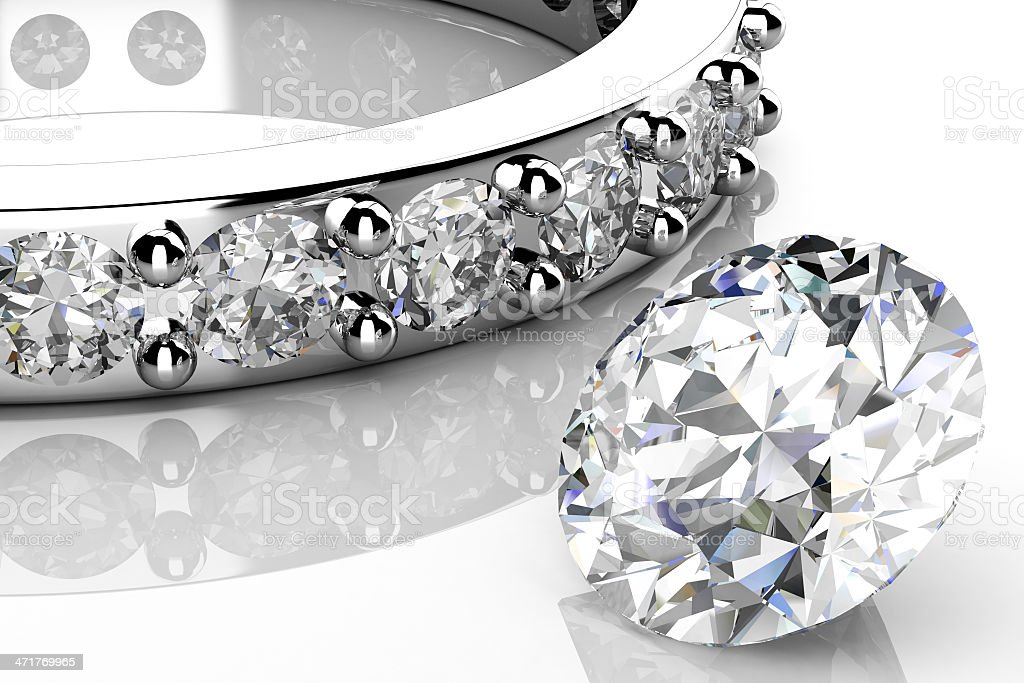 Loose diamond next to a diamond wedding band on white royalty-free stock photo