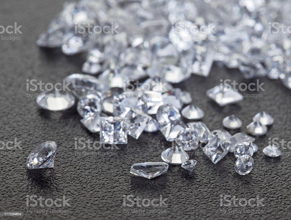Loose diamonds on black surface stock photo