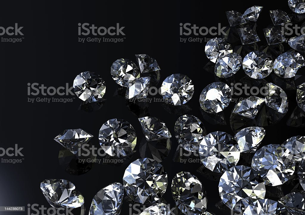 Loose diamonds scattered on black background stock photo