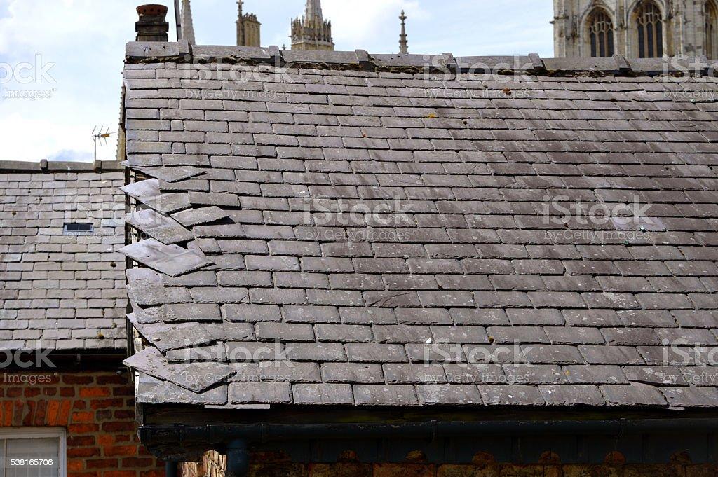 Loose slates on a house roof stock photo