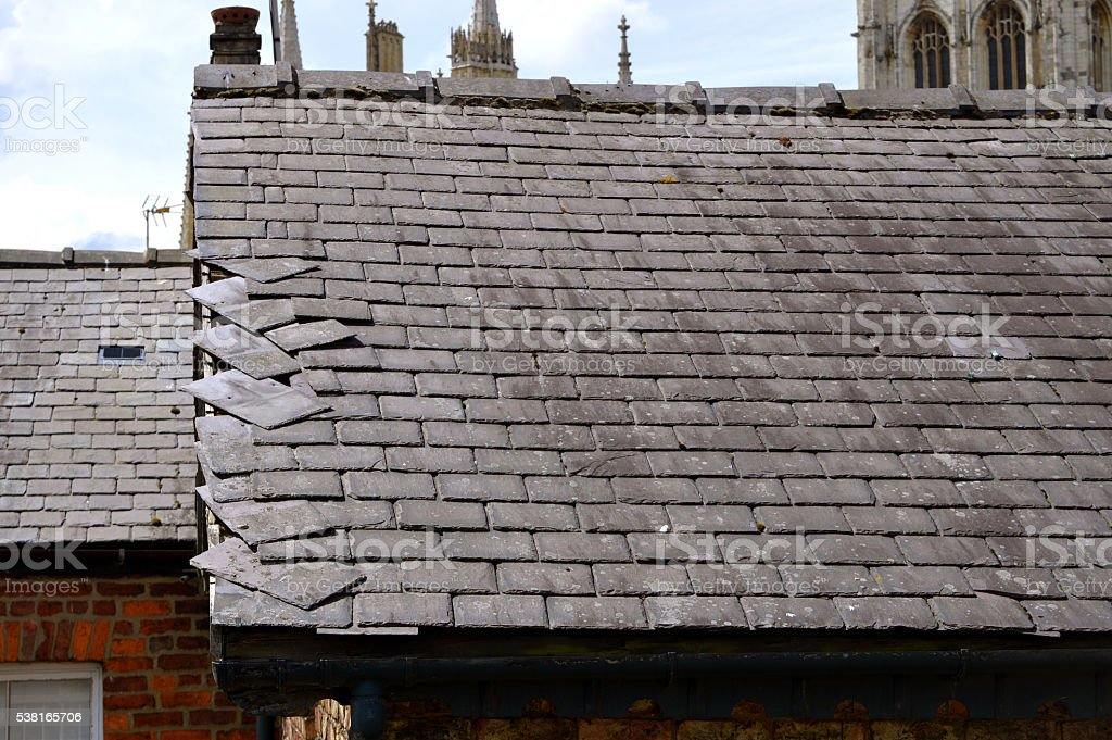 Loose slates on a house roof stock photo
