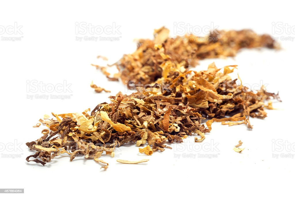 loose tobacco, close up isolated on white stock photo