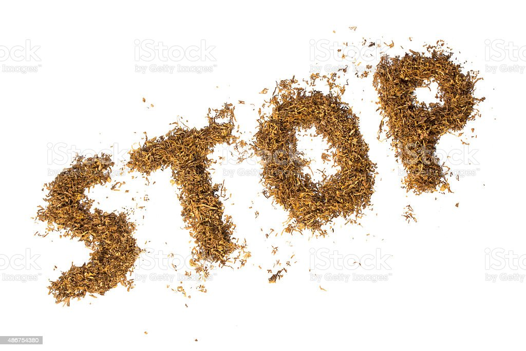loose tobacco formed into the word STOP, isolated on white stock photo