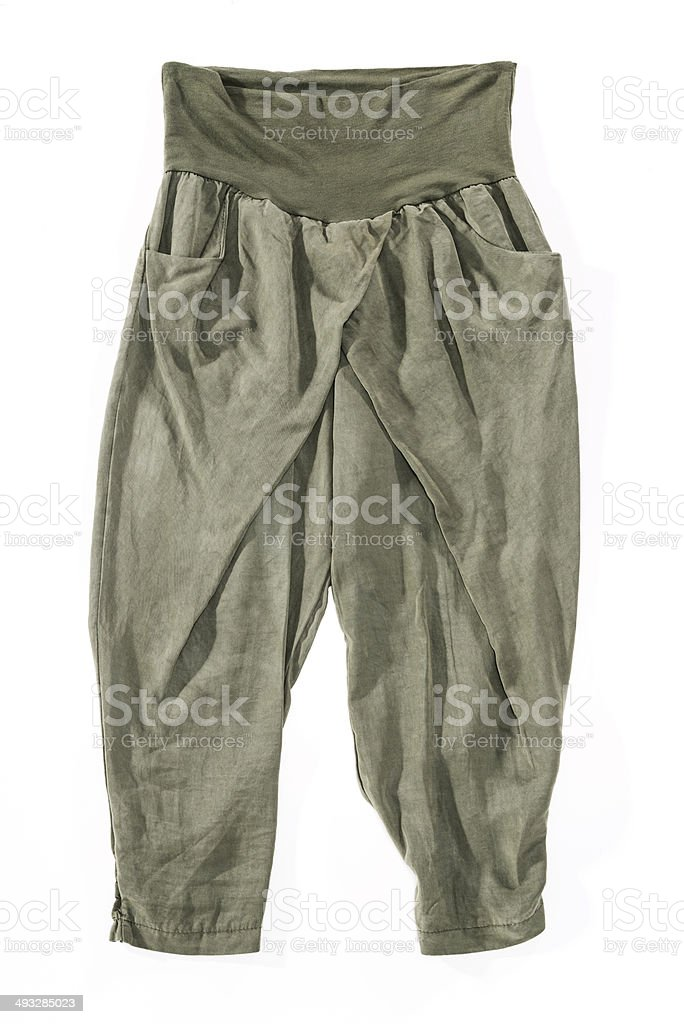 Loose, wrinkled italian fashion style olive women's trousers pants, isolated stock photo