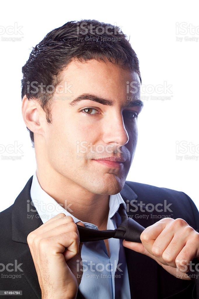 Loosening his tie stock photo