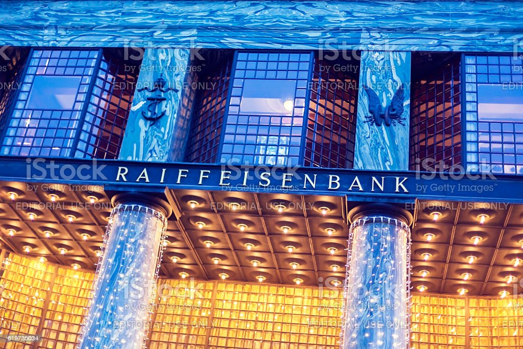 Looshaus with the Raiffeisen Bank signage at dusk stock photo