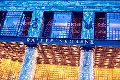 Looshaus with the Raiffeisen Bank signage at dusk