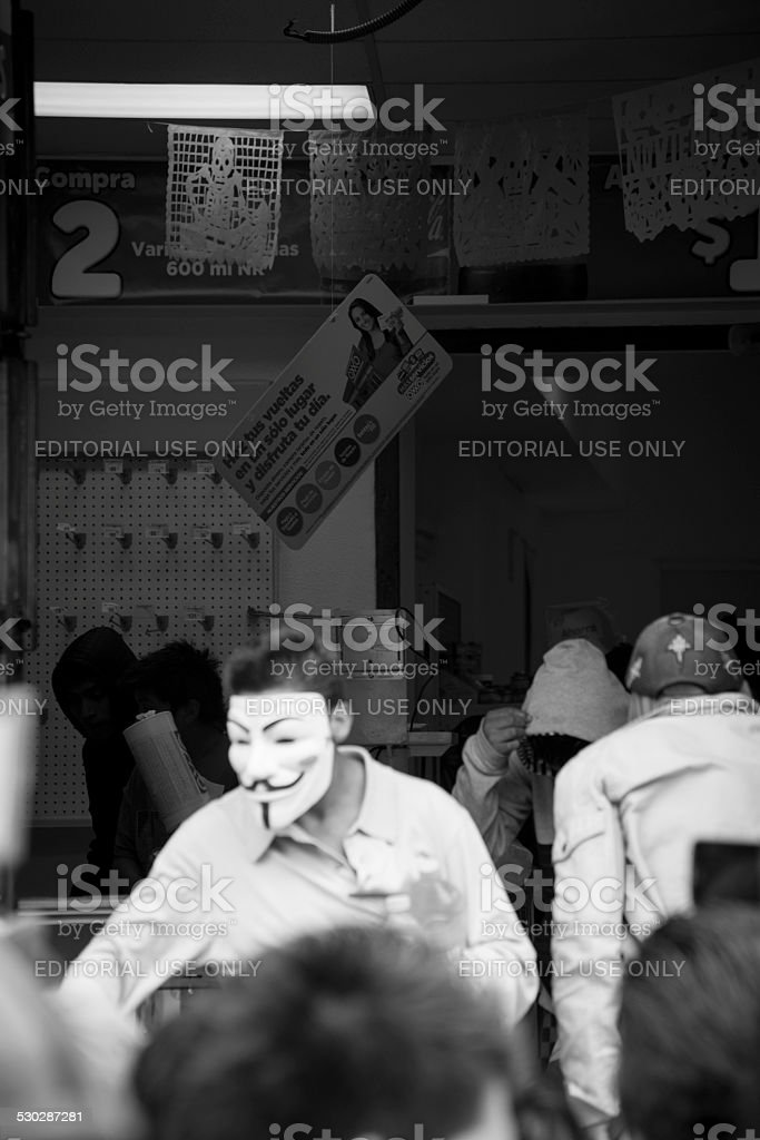 Looting with a V for Vendetta mask in Chiapas, Mexico stock photo