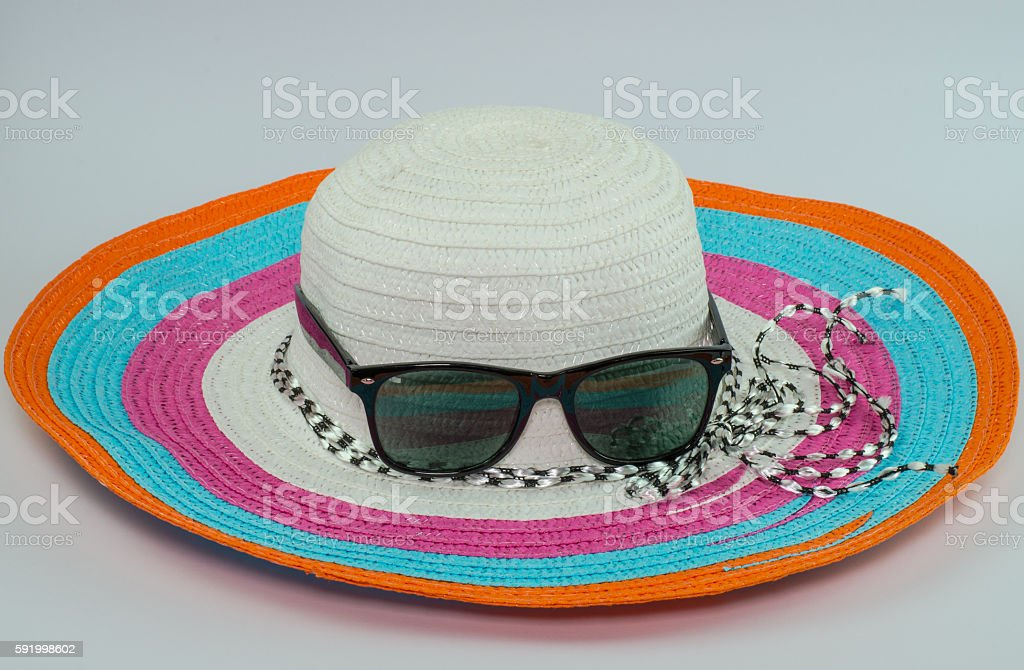 loppy beach hats sunglasses in various colors on white backgroun stock photo