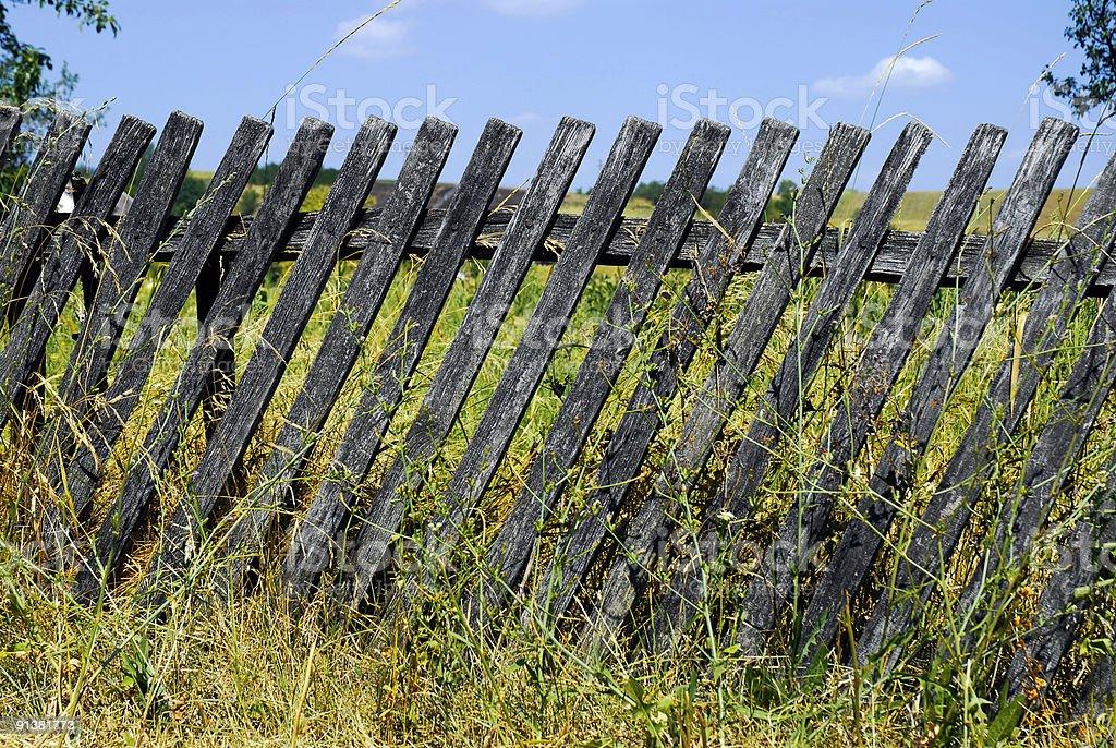 lopsided lath fence stock photo