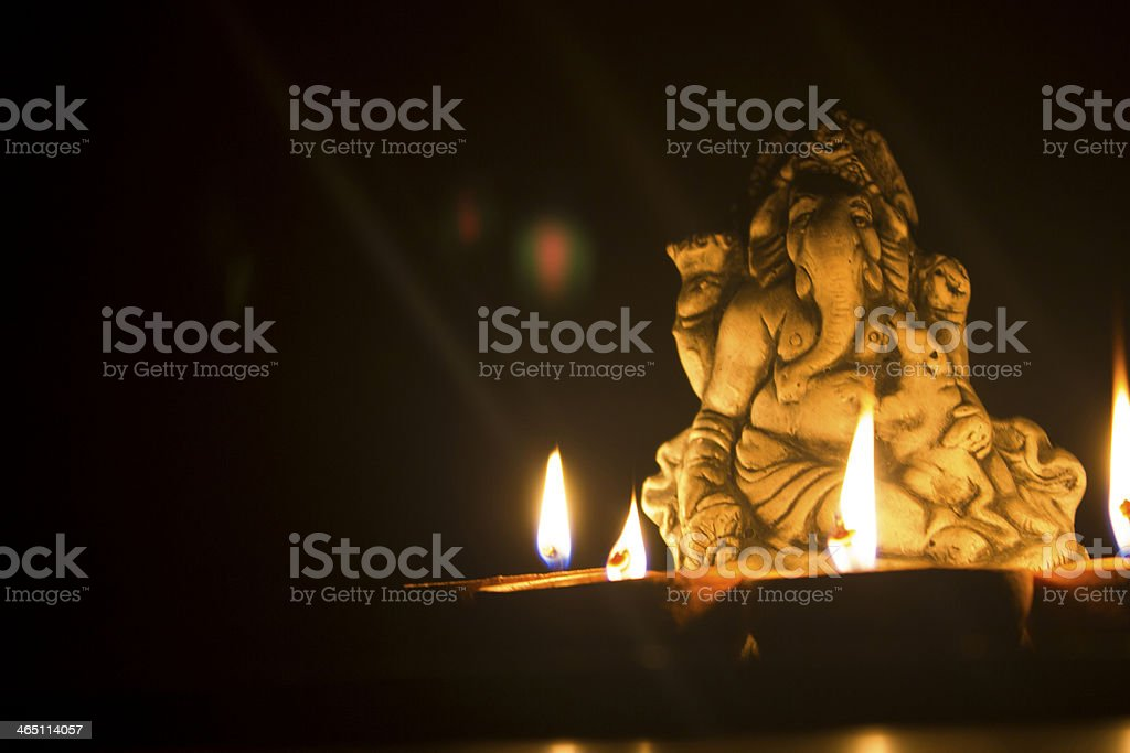 lord ganesha in lamplight stock photo