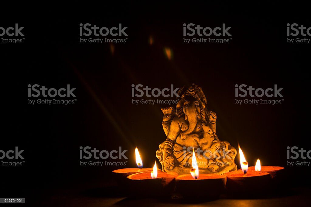 lord ganesha with oil lamp stock photo