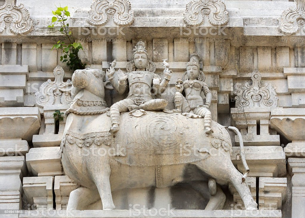 Lord Shiva and his wife Parvati on Nandi the bull. stock photo