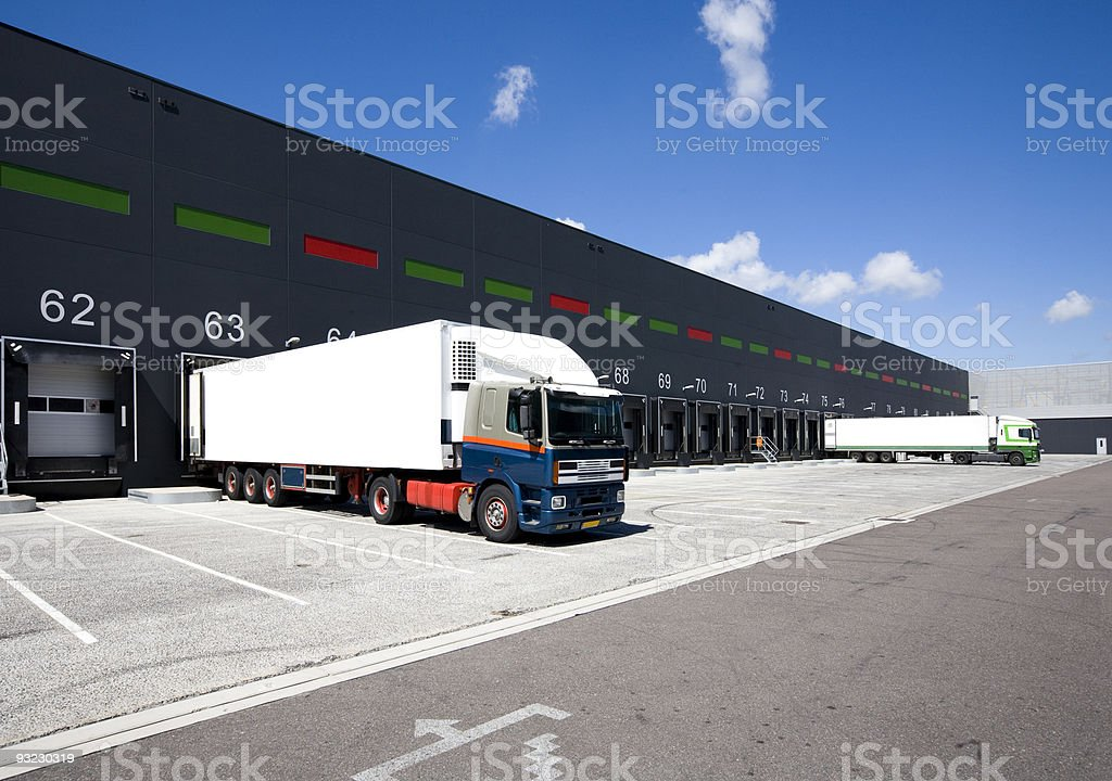 Lorry in a bay at loading docks stock photo