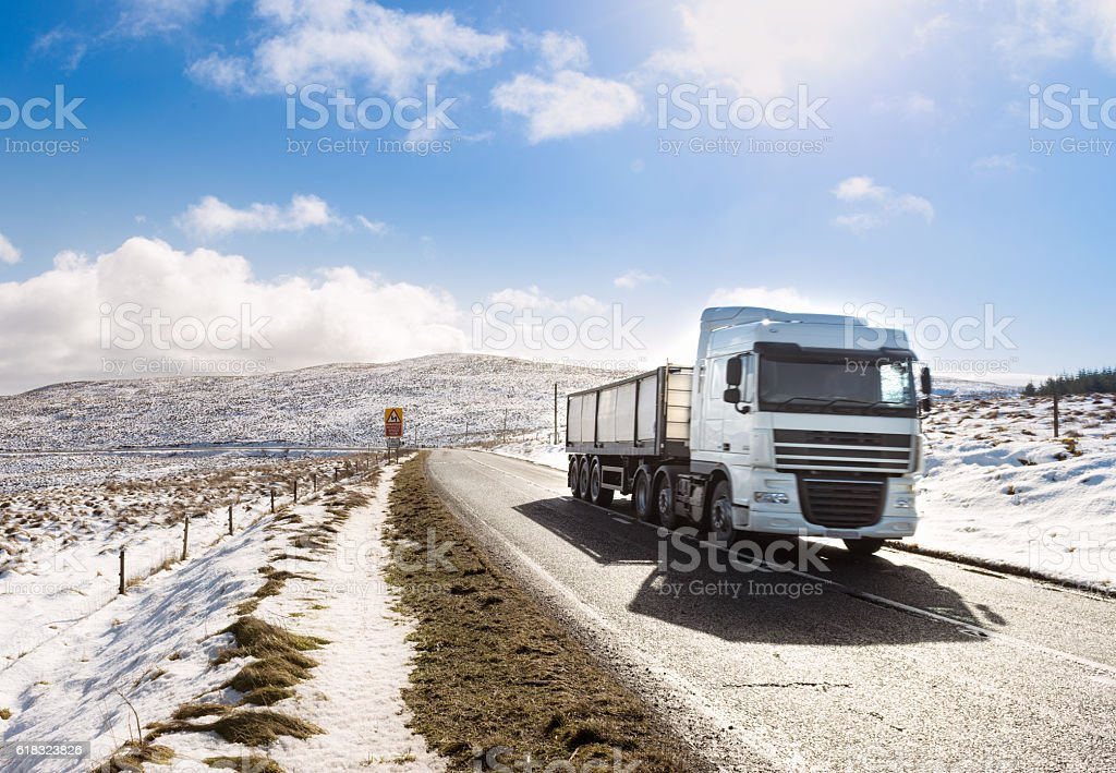 Lorry on rural British road in winter stock photo