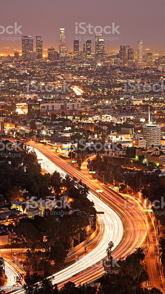 Los Angeles City Skyline and Highway at Night royalty-free stock photo