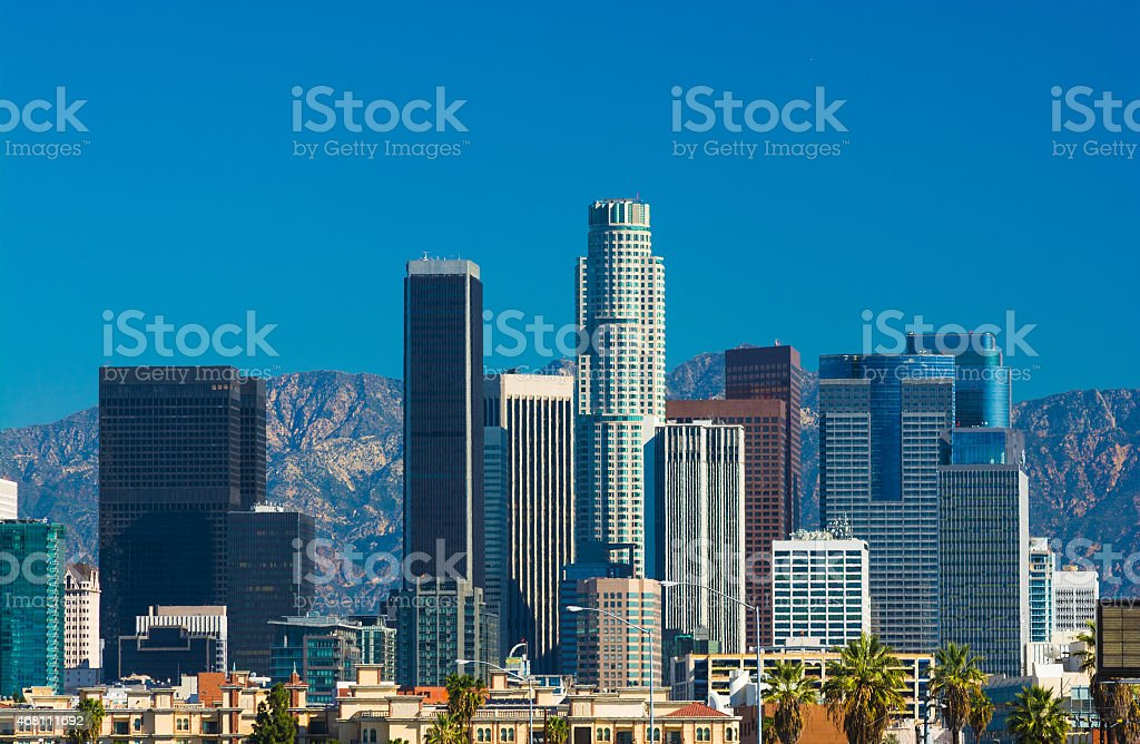 Los Angeles downtown skyscrapers close-up and San Gabriel Mountains stock photo
